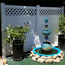 Vinyl garden private fence with lattice design