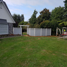 white post with grey sections private lattice fence