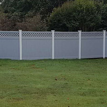 white post grey section private fence