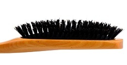 What are the benefits of combing hair with a natural bristle comb?