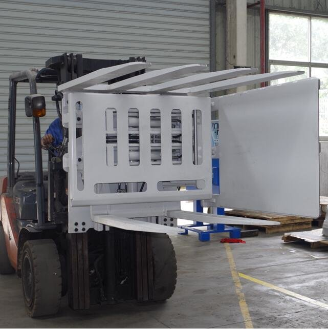 Pallet rotating forklift attachments