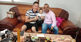 Indian customers and his baby come to our factory to talk about order cooperation. He will customize the Indian-style house model from our company.