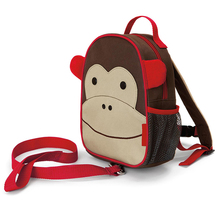 Plush monkey backpack with a mini stuffed monkey toy