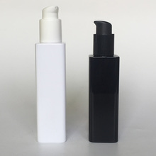 Black white square bottle with colorful spray pump