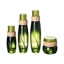 Wide Round Shape Glass Green Lotion Serum Bottle