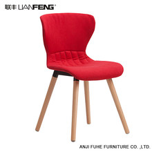 Modern simple red bar chair with sturdy wooden base