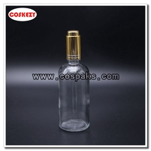 100ml Clear Pressed Bottle with Gold or Silver Button