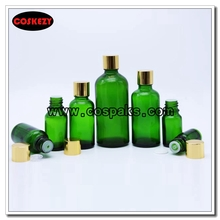Green bottle for Essential Oil with Gold Rotate Cap