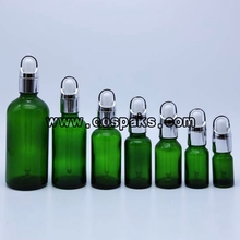 Wholesale Round Green Glass Bottle with Silver Overcap