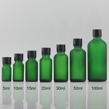 Green Frosted Glass Bottle With Black Cap